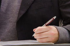 Businessman signing a document Stock Photos