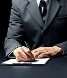 Businessman signing a document Royalty Free Stock Photography