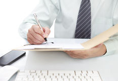 Businessman signing a document Royalty Free Stock Photo
