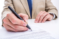 Businessman signing a document. Stock Photography