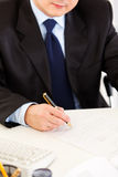 Businessman signing document. Close-up. Royalty Free Stock Photos