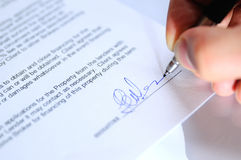 Businessman signing a document closeup Royalty Free Stock Photo