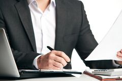 Businessman signing a document stock image