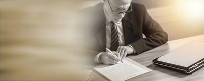 Businessman signing a document (lorem ipsum text used); light effect. Businessman signing a document in office (lorem ipsum text used); light effect royalty free stock photography