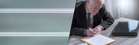Businessman signing a document (lorem ipsum text used). panoramic banner. Businessman signing a document in office (lorem ipsum text used). panoramic banner stock photography