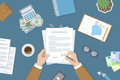Businessman signing a document. Man hands with pen and contract. The process of business financial agreement. Document with a signature. Desk with money purse Stock Photo