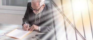 Businessman signing a document (lorem ipsum text used); multiple exposure. Businessman signing a document in office (lorem ipsum text used); multiple exposure royalty free stock photos