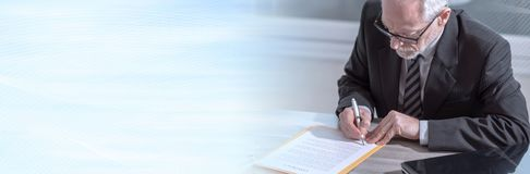 Businessman signing a document (lorem ipsum text used). panoramic banner. Businessman signing a document in office (lorem ipsum text used). panoramic banner stock photos