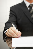 Businessman is signing document Stock Photo