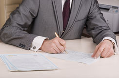 Businessman signing documents Stock Photography