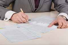 Businessman signing documents Royalty Free Stock Image