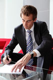 Businessman signing documents Royalty Free Stock Photography