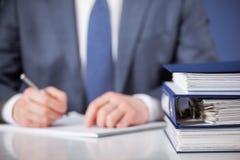 Businessman signing documents stock photos