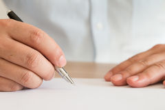 Businessman signing documents Stock Image