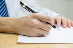 Businessman signing documents Royalty Free Stock Photo