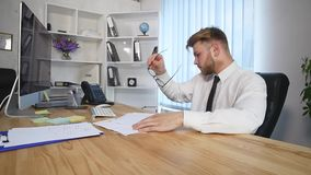 Businessman signing documents on office table stock video footage