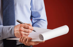 Businessman signing documents Royalty Free Stock Images