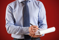 Businessman signing documents Stock Images