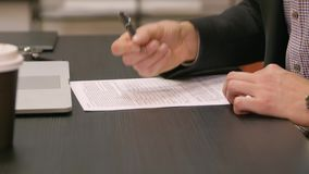 Businessman signing documents stock video