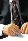 Businessman signing a form Stock Photography