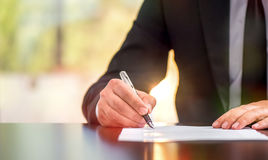 Businessman Is Signing A Legal Document Royalty Free Stock Photo