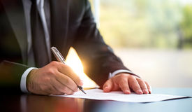 Businessman Is Signing A Legal Document Stock Image