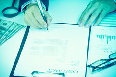 Businessman signing marketing contract.money. Royalty Free Stock Images