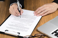 Businessman signing marketing contract.money. Royalty Free Stock Photography
