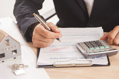 Businessman signing a mortgage Stock Images