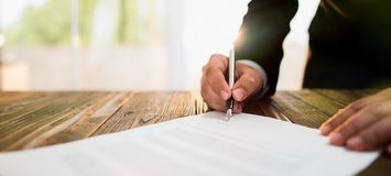 Signing Official Document. Businessman Signing An Official Document Royalty Free Stock Photo