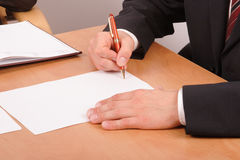 Businessman signing papers - 2. Businessman signing blank papers - close up royalty free stock images