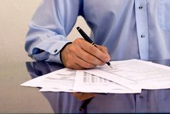 Businessman signing papers. Businessman doing paperwork, business and finance concept stock photography