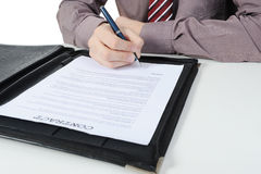 Businessman signs a contract Royalty Free Stock Images