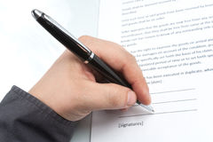 Businessman signs a contract Stock Photo