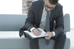 Businessman signs a contract. Holding pen in hand. Stock Photo