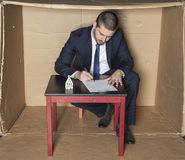 Businessman signs a contract insurance on the house Royalty Free Stock Image