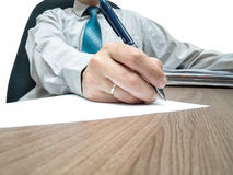 The businessman signs the contract Royalty Free Stock Image