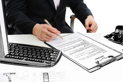 Businessman signs a contract Stock Photography