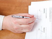 Businessman signs a contract by silver pen Royalty Free Stock Images
