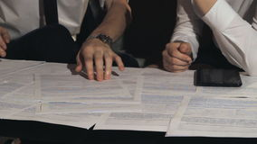 Businessman signs a document at work stock video