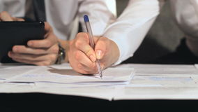 Businessman signs a document at work stock video footage