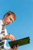 Businessman signs documents Stock Photo