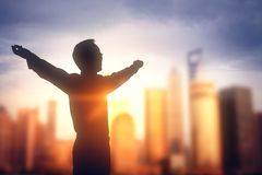 Businessman silhouette in blurry city royalty free stock photography