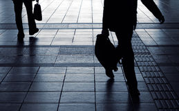Businessman silhouette carry briefcase Stock Images