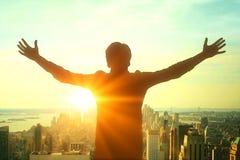 Businessman silhouette celebrating success Royalty Free Stock Photos