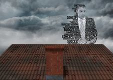 Businessman silhouette made up of words over roof. Digital composite of Businessman silhouette made up of words over roof Stock Photo