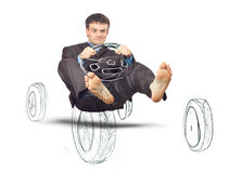 Businessman simulates driving a car Stock Images
