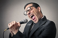 Businessman singing Stock Photo