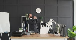 Businessman singing and dancing at office stock footage