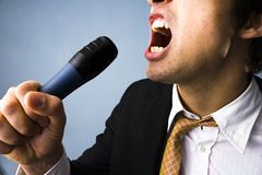 Businessman singing Royalty Free Stock Photography